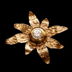 14kt. gold brooch with modified bezel set diamond