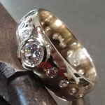Diamonds bezel and flush set in 14kt gold by Mallory Shelter