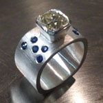 Mine cut diamond and flush set sapphires in funky ring by Mallory Shelter