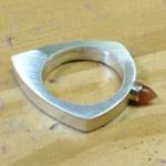 Geometric hollow bullet ring