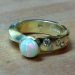 14kt gold ring with opal and diamonds